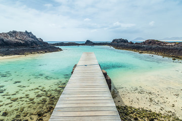 Deurstickers Canarische Eilanden Port of lobos island,in Fuerteventura, Canary islands, Spain. volcanic seascape. Turquoise and transparent water