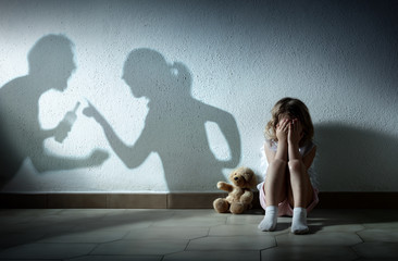 Little Girl Crying With Shadow Of Parents Arguing - Home Violence And Divorce Wall mural