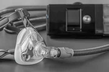 Sleep apnea CPAP mask on the grey table