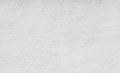 High resolution full frame background of a rough plastered concrete wall in black and white.