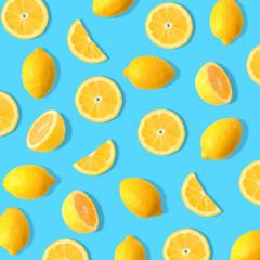 Summer fruit pattern of lemons and lemon slices on a bright blue background
