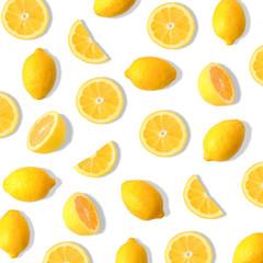 Summer fruit pattern of lemons and lemon slices on a white background