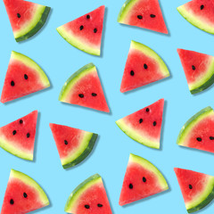 Colorful summer fruit pattern of watermelon slices on a pastel blue background