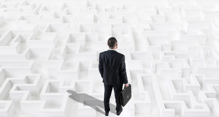 Businessman on a white large maze or labyrinth.Strategy Concept.