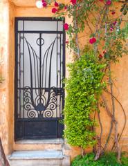 Athens Greece, vintage metall and glass house door, anafiotika picturesque neighborhood under acropolis