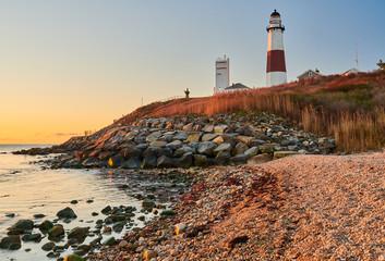 Montauk Lighthouse and beach at sunrise, Long Island, New York, USA.