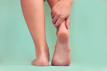 Woman feels strong foot pain isolated. People, healthcare and medicine concept