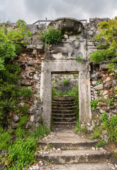 Stone entrance door with Venetian Lion of Kotor Fortress above the old town in Montenegro