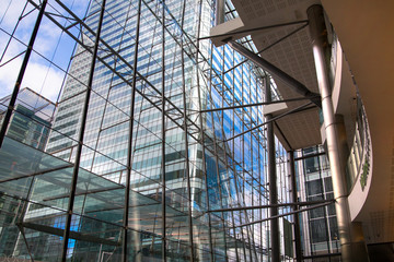 London, UK. Office building entrance hall in Canary Wharf. View at the Canada Tower. Beautiful glass reflection