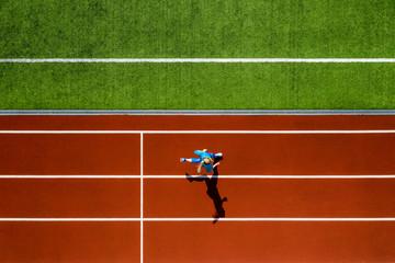 Sportive blonde woman running at open stadium