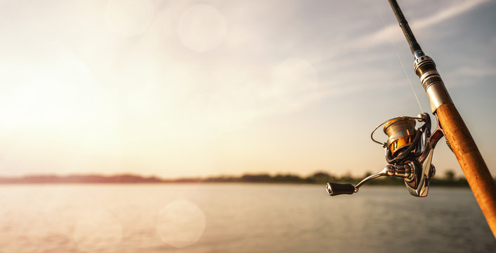 Close up of a fishing rod during the sunset with copy space