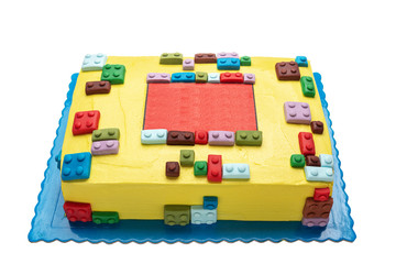 Cake from parts children's designer lego. On a white background for a birthday.