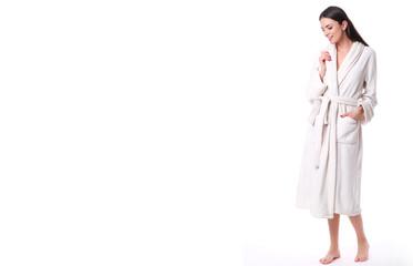 Studio shoot of model in white bathrobe.