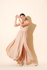 Dynamic high fashion shoot with model in long dress.