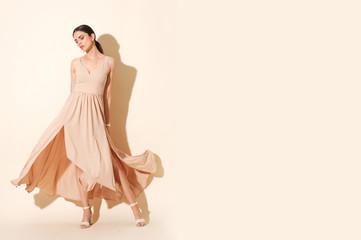 Beautiful shoot of model in long elegant dress.