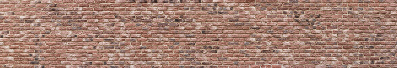 Panoramic high resolution vintage pink, black and red brick wall background texture. Architecture...