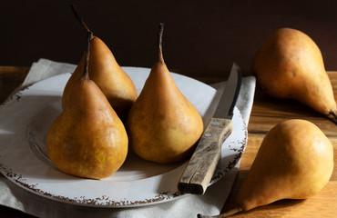 Ripe pears in a rustic setting.