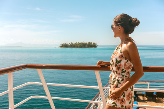 Cruise ship travel vacation luxury tourism woman looking at ocean from deck of sailing boat. Luxury Tahiti Bora Bora French Polynesia destination summer lifestyle.