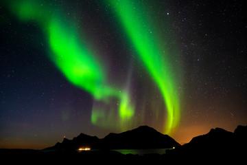 Aurora borealis over the mountains of Lofoten, Norway.