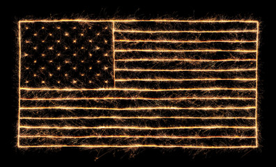Wall Mural - 4th of July sparklers lit up in the shape of the American Flag