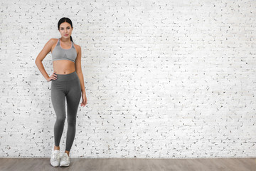 Sport woman in sportswear relax stand after workout against copy space for adding text with white wall background.Diet concept.Fitness and healthy lifestyle