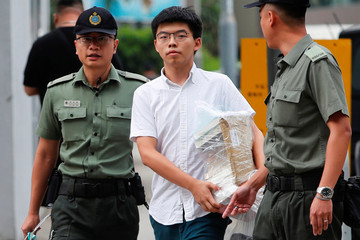 """Former student leader Joshua Wong walks out from prison after being jailed for his role in the Occupy Central movement, also known as """"Umbrella Movement"""", in Hong Kong"""