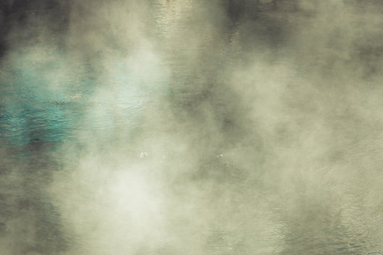 Background image of steam rising above a hot water thermal pool