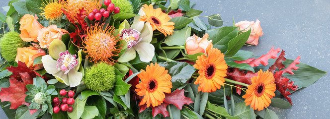Flower arrangement. Overhead view and close up of orange flowers. Floral  banner.