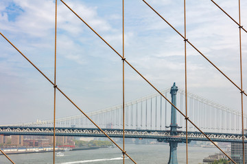 Fototapete - Manhattan Bridge over East river, New York city, view from Brooklyn bridge