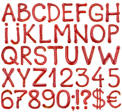 Letters of the alphabet written ketchup sauce.