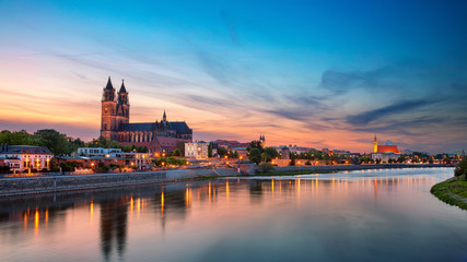 Magdeburg, Germany. Panoramic cityscape image of Magdeburg, Germany with reflection of the city in the Elbe river, during sunset. Wall mural