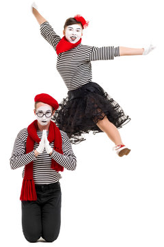 Smiling mimes in striped shirts. surprised man and jumping woman isolated on white background