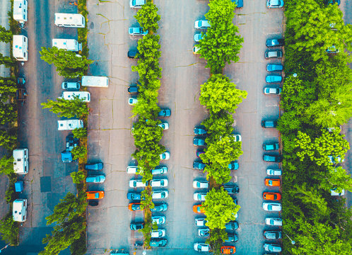 Aerial view of a large parking lot with vehicles