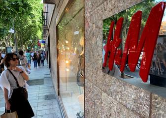 An H&M sign is seen at the entrance to an H&M store in Palma on the island of Mallorca