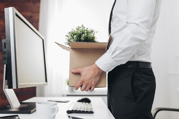 Businessman clearing his desk after being made redundant
