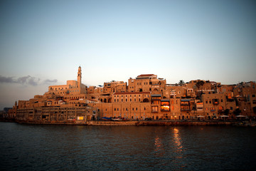 Lights are reflected in the Mediterranean Sea, as a view of Jaffa Port is seen at sunset, in Jaffa, Israel
