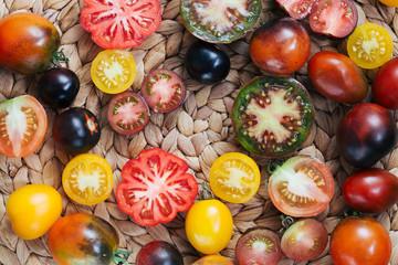wicker kitchen mat and cut organic tomatoes