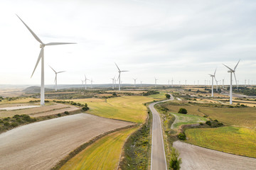 wind turbine, road and fields