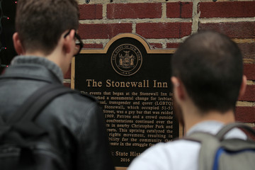 People look at the historical landmark sign outside The Stonewall Inn in New York