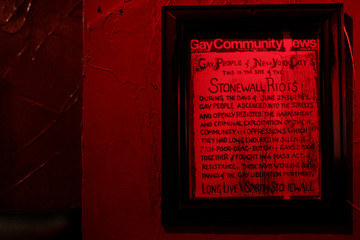 A sign is displayed on the wall inside the Stonewall Inn in New York