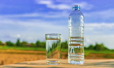Clean water on wooden floors Natural background (health concept)