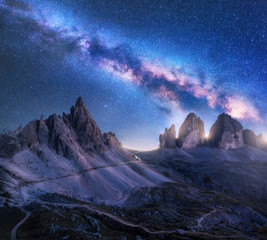 Wall Mural - Bright Milky Way over mountains at starry night in summer. Amazing landscape with alpine mountains, blue sky with milky way and stars, high rocks. Tre Cime in Dolomites, Italy. Space. Beautiful nature