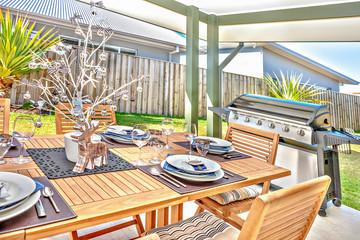 Outdoor dining table with ceramic and decorations.