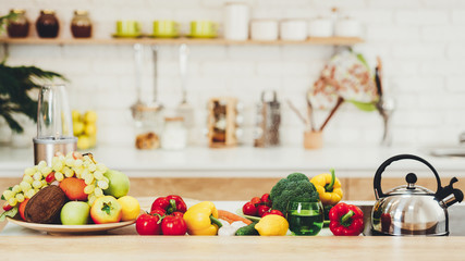 Fresh Fruits And Vegetables On Kitchen Table
