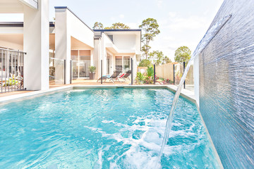 Swimming pool design with water and house garden.