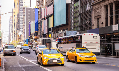 Fototapete - New York, streets. High buildings, colorful signs, cars and cabs