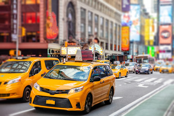 New York, Broadway streets. High buildings, colorful neon lights, ads and cars