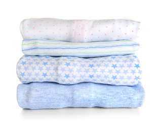 Stack of baby clothes on white background