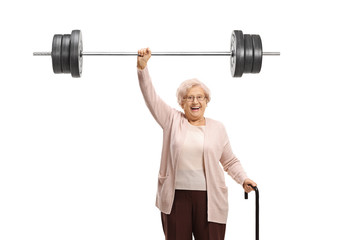 Senior woman with a cane liftiing a barbell
