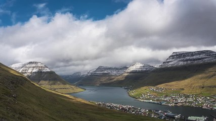 Wall Mural - Timelapse of clouds moving above Klaksvik and nearby mountains on Faroe Islands